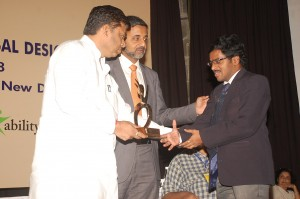Shri. Balaram Nayak, Hon'ble Minister of Social Justrice and Empowerment, Government of India - presenting shield to Srinivasu