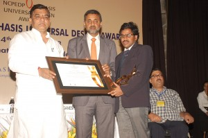 Mr. Balaram Nayak, Hon'ble Minister of Social Justice and Empowerment presenting Certificate of Award to Srinivasu